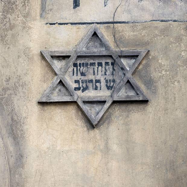 The Star of David on an old house wall in the historic Jewish Kazimierz district, Krakow, Poland.