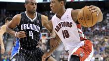 Toronto Raptors forward DeMar DeRozan drives to the basket against Orlando Magic guard Arron Afflalo (L) during the first half of their NBA game in Toronto November 18, 2012. (MIKE CASSESE/REUTERS)