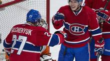 Montreal Canadiens' Brendan Gallagher, right, celebrates with teammate Alex Galchenyuk, left, after scoring against the Philadelphia Flyers' during third period NHL action in Montreal, Saturday, October 5, 2013. (Graham Hughes/THE CANADIAN PRESS)