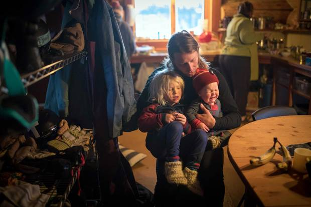 Dave Treadway holds his sons Kasper, left, and Raffi at Tweedsmuir Ski Club's backcountry cabin.