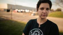 Elisa Gurule, 34, is not sure what future she has in the auto industry. Her current job, installing seat belts and windshields at a Chrysler assembly plant in Sterling Heights, Mich., pays $17.53 an hour. (Geoff Robins For The Globe and Mail)