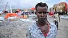 Dock workers are seen at a seaport in Mogadishu, Somalia Oct. 30, 2012, where economic activity has resumed after almost two decades of civil war. The country also depends on goods that go through the major Kenyan port of Mombasa, where dock workers are on strike. (HANDOUT/Reuters)