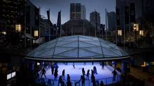 Skaters on the ice at Vancouver's Robson Square on Dec. 6, 2011. (JOHN LEHMANN/The Globe and Mail)