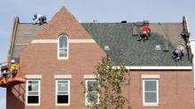 Builders work at the roof of a new housing construction site in Alexandria, Va., Oct. 17, 2012. On Friday, jobs figures for February showed that there were 48,000 construction jobs created in the U.S. in the month, the most since March 2007. (KEVIN LAMARQUE/REUTERS)