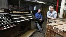 Jacquelin Rochette (L ), Artistic director and Denis Blain, technical director at Casavant Freres pose with the console and boxes containing the rest of a pipe organ removed from Saint Charles church of Limoilou, in Saint-Hyacinthe, Quebec May 1, 2014. Parishes in Quebec are shutting their churches and ending up with valuable pipe organs they're unable to maintain. One such organ, removed Monday from the St. Charles church in Quebec City, has been sold to a church in Norway. (Christinne Muschi/Christinne Muschi/The Globe and)