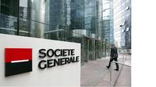 An employee enters the headquarters of French bank Societe Generale (JOHN SCHULTS/John Schults/Reuters)
