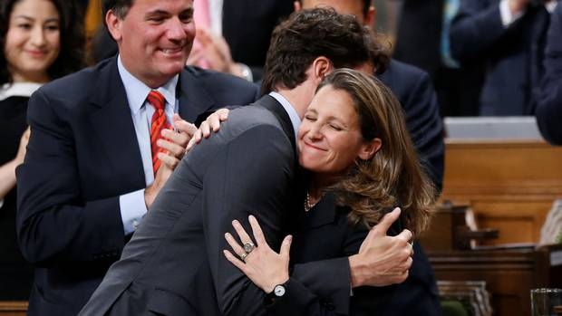 Prime Minister Justin Trudeau embraces Foreign Affairs Minister Chrystia Freeland after she delivered a speech on Canada's foreign policy in the House of Commons on June 6, 2017.