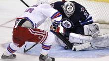 Winnipeg Jets' goaltender Ondrej Pavelec (31) stops New York Rangers forward Marian Gaborik (10) on the penalty shot during first period NHL action in Winnipeg on Thursday, March 14, 2013. (JOHN WOODS/THE CANADIAN PRESS)