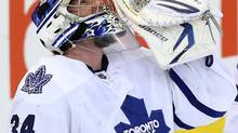 Toronto Maple Leafs goaltender James Reimer looks up as he celebrates the defeating the Ottawa Senators 4-1 after NHL action in Ottawa Saturday April 20, 2013. Reimer is a key reason for his team's success this season writes James Mirtle. (FRED CHARTRAND/THE CANADIAN PRESS)