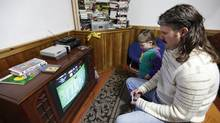 Blair McMillan plays an old Nintendo game on a cathode-ray television. (Deborah Baic/The Globe and Mail)