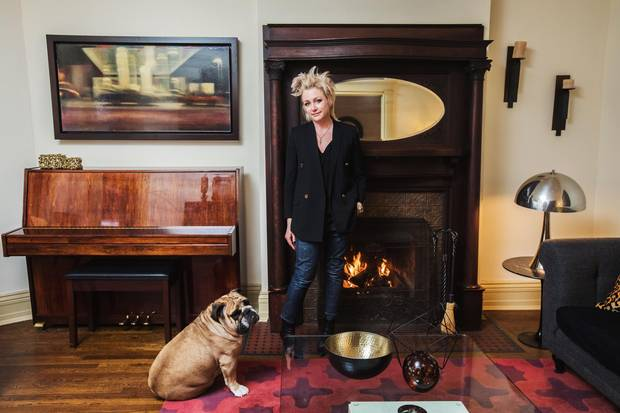 Lawyer Kim Schofield and her dog Spud in the living room of their Parkdale home.