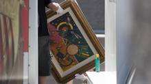 Artwork by Russian painter Wassily Kandinsky is loaded onto a truck during a seizure in Boulder City, Nev., about 20 miles southeast of Las Vegas. The seizure is apparently related to the arrest of German fugitive Ulrich Felix Anton Engler, 51, who is accused of bilking investors in a multimillion-dollar Ponzi scheme. (STEVE MARCUS/REUTERS)