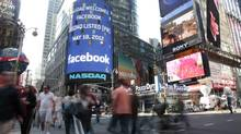 Nasdaq's giant monitor in New York's Times Square is seen as Facebook's stock is set to begin trading on May 18, 2012. (Bebeto Matthews/Associated Press)