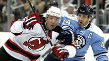 Ilya Kovalchuk of the New Jersey Devils battles through Brooks Orpik of the Pittsburgh Penguins at Consol Energy Center on December 6, 2010 in Pittsburgh, Pennsylvania. (Justin K. Aller/Getty Images)