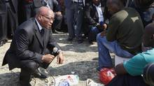 South Africa's President Jacob Zuma talks with striking mine workers at the Lonmin mine near Rustenburg, South Africa, this week. The government is reviving mediation efforts.