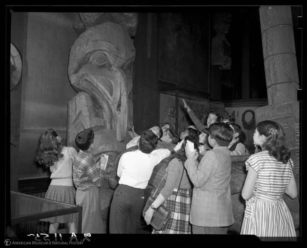A public-school class takes a tour of the Northwest Coast Hall in 1947.