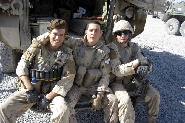 Mr. Kennedy (centre) at patrol base Sperwan Ghar in Kandahar, Afghanistan, in September, 2010. He is with members of Charles Company, 1st Battalion, Royal Canadian Regiment.