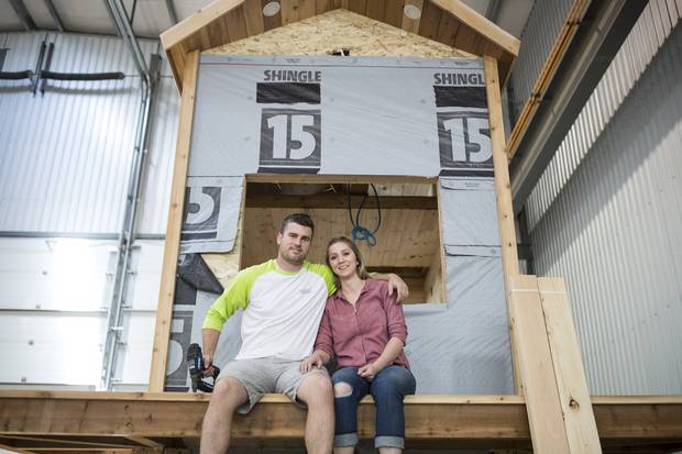 Tyson Leavitt, CEO, craftsman and builder of Charmed Playhouses and his wife Audrey design and build luxury children playhouses in Lethbridge, Alberta.