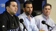 Toronto Blue Jays player Jose Bautista (right) speaks with general manager Alex Anthopoulos and at their MLB American League spring training facility in Dunedin, Florida, February 17, 2011 (file). (MIKE CASSESE/REUTERS)