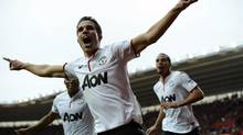 Manchester United's Robin van Persie celebrates after scoring a hat-trick against Southampton during their English Premier League match at Saint Mary's Stadium in Southampton, southern England September 2, 2012. (DYLAN MARTINEZ/Reuters)