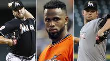 This photo combo made from file photos shows Miami Marlins players, from left, pitcher Mark Buehrle, shortstop Jose Reyes, and pitcher Josh Johnson. Miami traded the three players to the Toronto Blue Jays, a person familiar with the agreement said Tuesday, Nov. 13, 2012. (Associated Press)