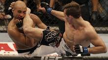 Rory MacDonald, right, kicks BJ Penn in the third round of a welterweight mixed martial arts bout at a UFC on FOX event in Seattle, Saturday, Dec. 8, 2012. MacDonald won by unanimous decision. (Jeff Chiu/AP)