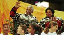 Nelson Mandela with wife, Graca Machel, waves to thousands of children during an appearance at Toronto's then-Skydome Sept. 25, 1998. (Tibor Kolley/Tibor Kolley/The Globe and Mail)