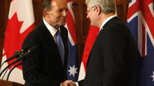 Canada's Prime Minister Stephen Harper (R) and his Australian counterpart Tony Abbott shake hands at a joint news conference on Parliament Hill in Ottawa June 9, 2014. (PATRICK DOYLE/REUTERS)
