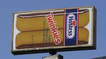 A Hostess Twinkies sign perches atop the Utah Hostess plant in Ogden, Utah. Hostess Brands Inc. says it's in talks with more than 100 parties interested in buying its brands, which include Twinkies, Ding Dongs and Ho Hos. (Rick Bowmer/AP)