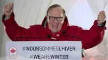 Canadian Olympic Committee president Marcel Aubut reacts as he announces the Canadian snowboard team for the Sochi Olympics, Tuesday, January 21, 2014 in Quebec City. (The Canadian Press)