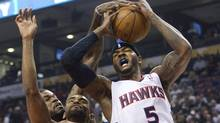 Toronto Raptors forward Alan Anderson, left, battles for the ball against Atlanta Hawks forward Josh Smith on Monday. (Nathan Denette/The Canadian Press/Nathan Denette/The Canadian Press)