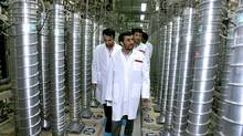 Iranian President Mahmoud Ahmadinejad, middle, visits the Natanz Uranium Enrichment Facility in April, 2008. (IRANIAN PRESIDENT'S OFFICE/ASSOCIATED PRESS)