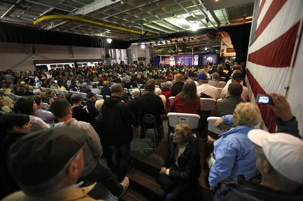 An overflow crowed fills the hangar deck of the USS Yorktown as Republican presidential candidate, businessman Donald Trump, speaks during a rally coinciding with Pearl Harbor Day at Patriots Point aboard the aircraft carrier USS Yorktown in Mt. Pleasant, S.C., Monday, Dec. 7, 2015.