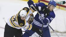 Boston Bruins Adam McQuaid (54) and Maple Leaf James van Riemsdyk (21) battle it out during second period of game game six NHL eastern conference playoff May 12, 2013. (Moe Doiron/The Globe and Mail)