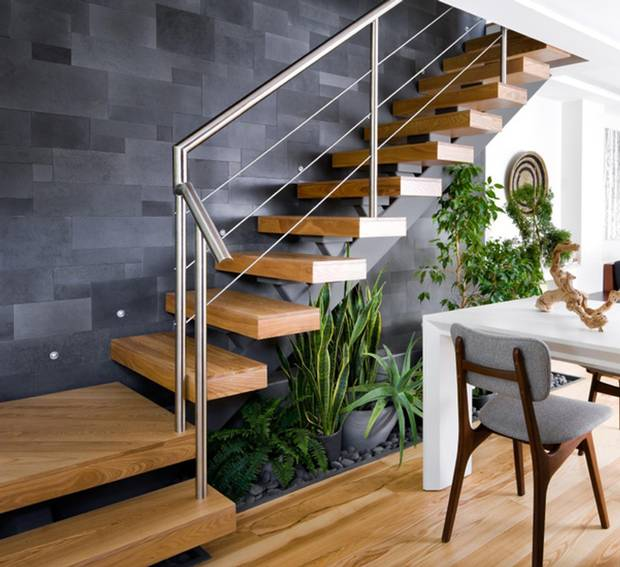 Designers Sarah Keenleyside and Lindsay Konior installed a garden underneath a staircase of a Toronto townhouse.