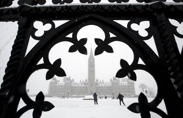 People walk on Parliament Hill during the snowstorm.