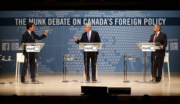 Liberal Leader Justin Trudeau, Conservative Leader Stephen Harper, and New Democratic Party Leader Thomas Mulcair take part in the Munk leaders' debate on Canada's foreign policy in Toronto on Sept. 28, 2015.