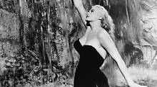 A still image of Anita Ekberg at the Trevi Fountain in the film La Dolce Vita.
