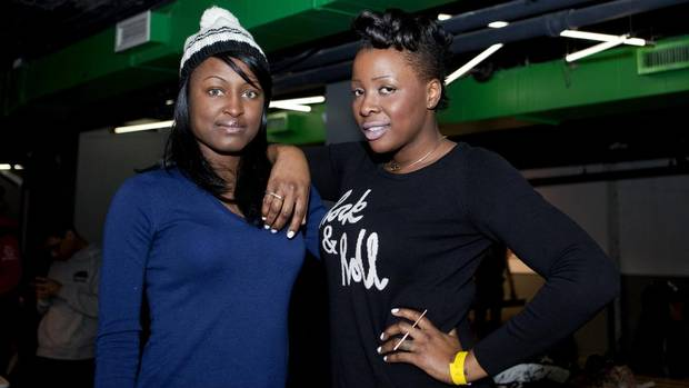 Olecia Miller (left) and Gellaine Clarke during a ping pong tournament in support of the Remix Project held at SPiN Toronto. (Della Rollins for The Globe and Mail)