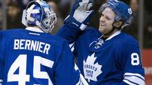 Toronto Maple Leafs goaltender Jonathan Bernier (left) and Phil Kessel celebrate after defeating the Tampa Bay Lightning in NHL action in Toronto on Tuesday January 28, 2014. (Frank Gunn/THE CANADIAN PRESS)