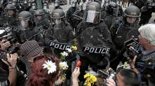 Demonstrators with flowers face riot police during protests ahead of the G20 summt in Toronto June 26, 2010. (Mark Blinch/Reuters/Mark Blinch/Reuters)
