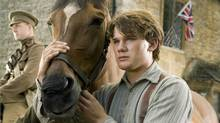 "Albert (Jeremy Irvine) and his horse Joey are featured in this scene from DreamWorks Pictures' ""War Horse."" (Andrew Cooper / Dreamworks)"