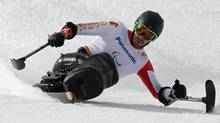Canada's Josh Dueck skis during the Men's Sitting Skiing Downhill at the 2014 Sochi Paralympic Winter Games at the Rosa Khutor Alpine Center March 8, 2014.  (Reuters)