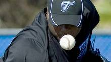 Toronto Blue Jays pitcher Frank Francisco keeps a close eye on the ball during baseball spring training in Dunedin, FL, on Tuesday, Feb. 15, 2011. THE CANADIAN PRESS/Nathan Denette (Nathan Denette)