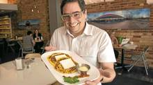 Eduardo Lee serves Venezuelan arepas made from Ontario corn at his restaurant in Toronto. (Kevin Van Paassen/The Globe and Mail)
