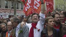 Left Front leader Jean-Luc Melanchon, centre, gestures as he marches during a rally to protest the austerity measures of French President Francois Hollande in Paris, May 5, 2013. (Michel Euler/AP)