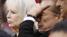 Los Angeles Clippers owner Donald Sterling, right, puts his hand over his face as he sits courtside with his wife Shelly while the Clippers trail the Chicago Bulls in the second half of their NBA basketball game in Los Angeles in this December 30, 2011 file photo. (DANNY MOLOSHOK/REUTERS)