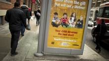 A bus shelter on King Street, west of Spadina Ave., in Toronto carries an advertisement for the Catholic School Board's French immersion program on Feb. 05, 2013. (PETER POWER/THE GLOBE AND MAIL)