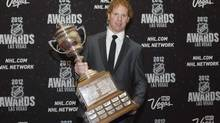 Florida Panthers defenseman Brian Campbell poses with the Lady Byng Trophy (STEVE MARCUS/REUTERS)