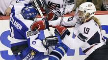 Finland's Marjo Voutilainen, left, is hit by USA's Giji Marvin during a game in Vancouver on Aug. 31. (LYLE STAFFORD)